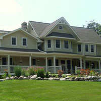 craftsman style farmhouse with wrap around front porch