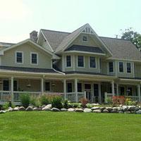Elegant craftsman style farmhouse with wrap around front porch