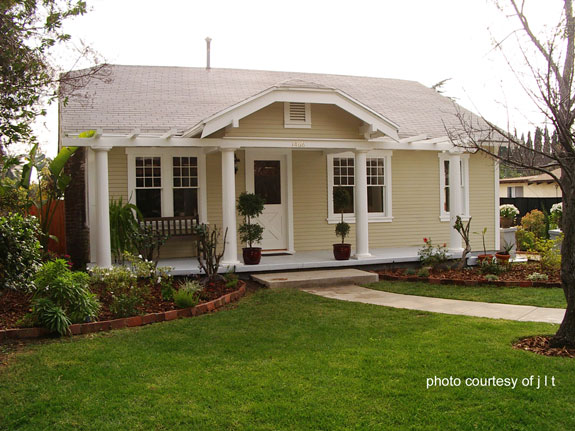 New craftsman style home hip roof and pergola extensions