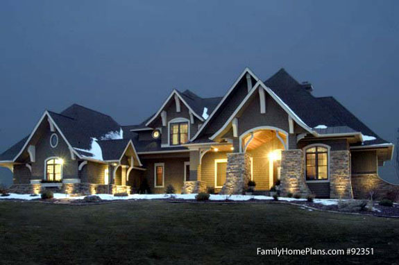 Craftsman home at night Family Home Plan # 92351