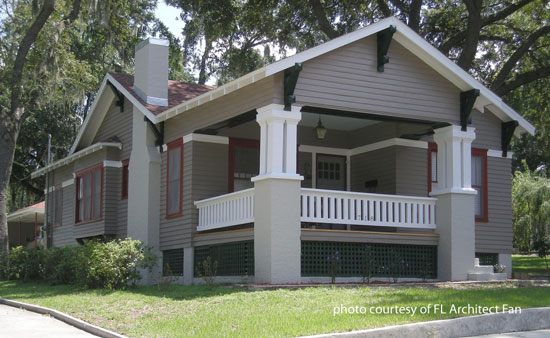 arts and craft style home with wide front porch and triple columns