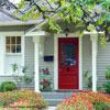 front porch with vivid red door