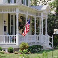 curb appealing front porch with flag