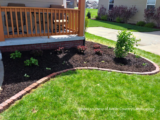 curved planting bed in front of porch