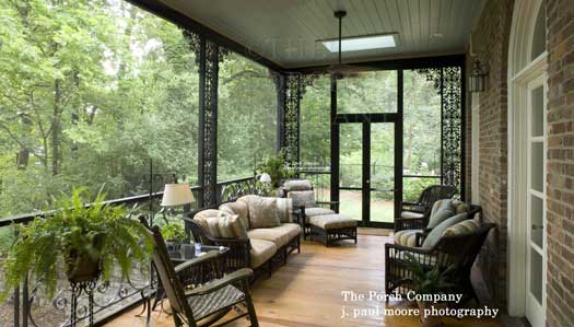 enclosed porch with wrought iron railings and columns