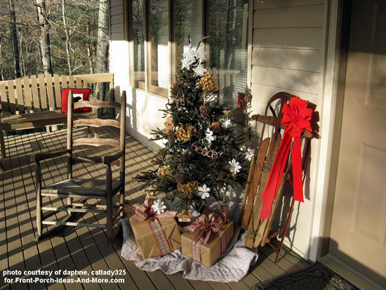 decorated sled and christmas tree on front porch
