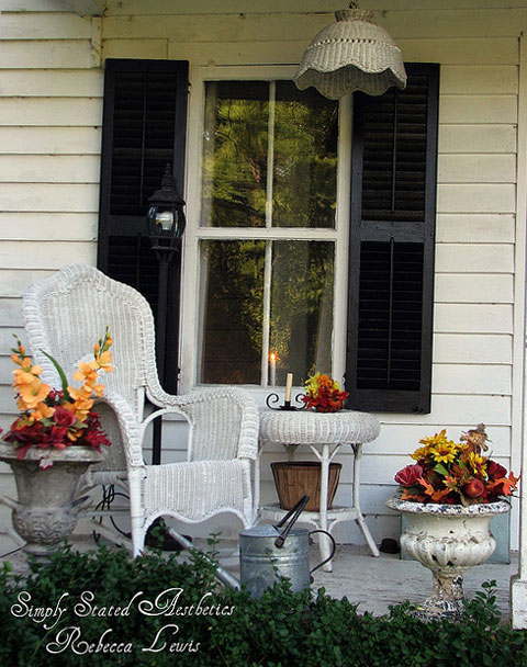 Wicker chairs and table on Rebecca's lovely autumn porch