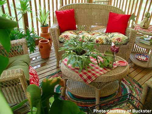 Porch decorating with red - wicker porch furniture makes a nice conversation area