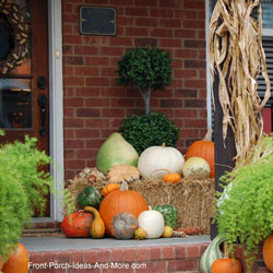 porch with pumpkins and corn stalks for fall