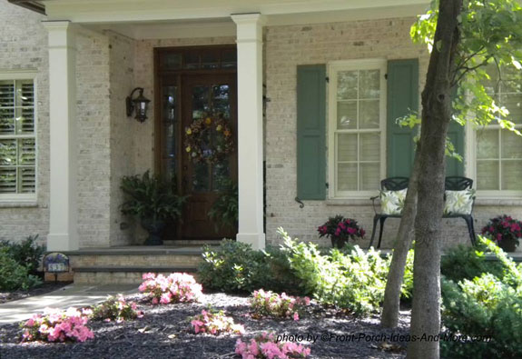 easy well maintained landscaping in front of porch