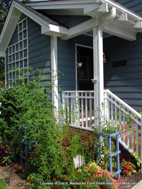 small porch with edible and ornamental landscaping