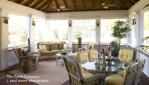 enclosed porch with outdoor rug and sconce lighting