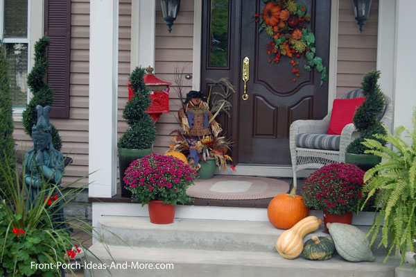 Front porch with old fashioned mailbox and fall decorations