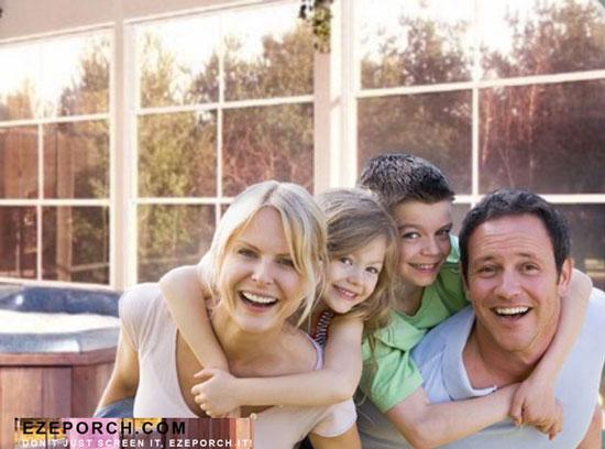 family enjoying ezeporch windows in porch enclosure