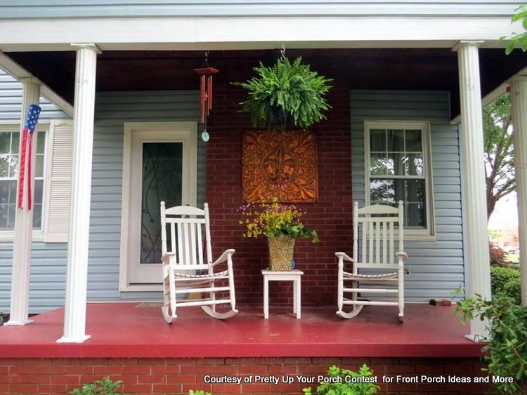 Outdoor artwork on front porch is a focal point