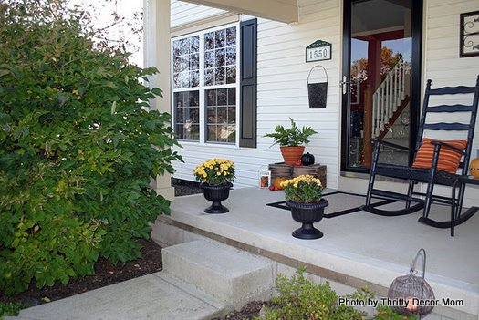 mums frame the autumn porch steps