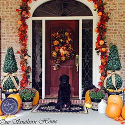 beautiful fall garland around red front door