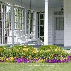 farmhouse porch with classic porch swing