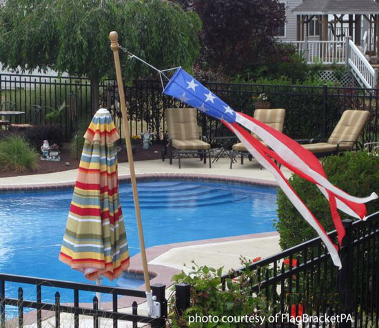 banner flag bracket installed on front porch railing