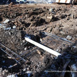 rebar positioned in footing trench