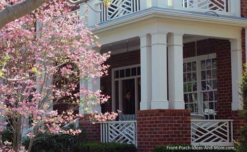 blooming redbud tree in front of porch in Franklin Tennessee