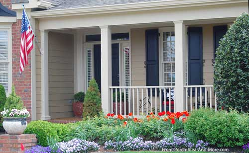curb appealing front porch with colorful landscaping