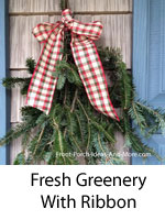 fresh evergreen boughs with ribbon