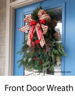 front door wreath with fresh greenery and decorations