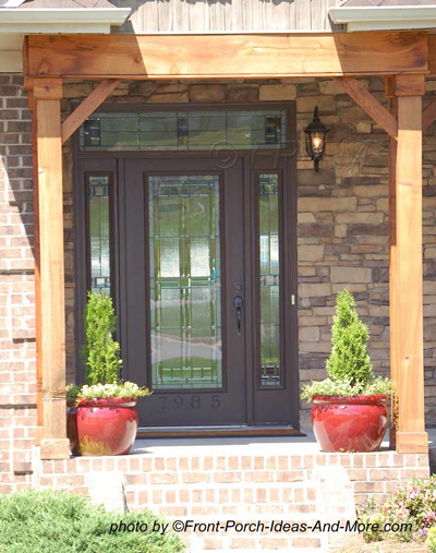 front door with side lights and transom above