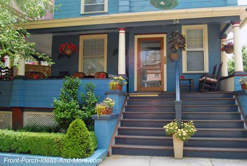 Landscaping with a hedge and potted plants