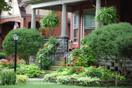 front porch with established front yard landscaping