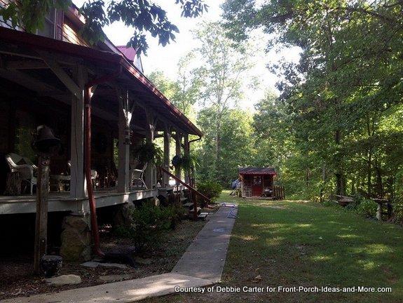 Fia's playhouse is next to her Grandma's big house