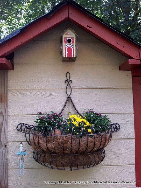 Fia's playhouse close-up of planter and bird house