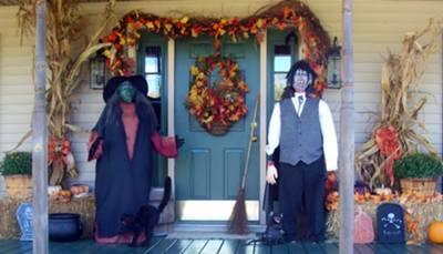 scary halloween figures guard the front door