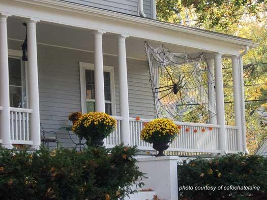 Spider web spun between porch columns for Halloween