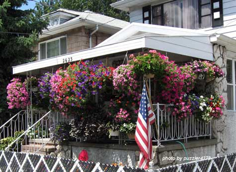 Amazing number of colorful baskets on this porch