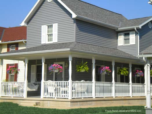 farmhouse with large porch and hanging baskets
