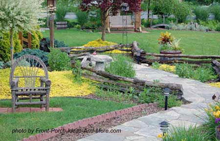 Front yard landscaping with separate flower beds along the walkway