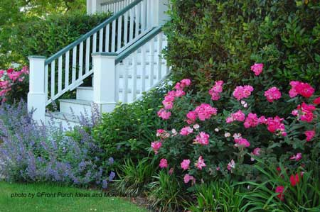 Front house landscaping where the flowers complement the porch colors