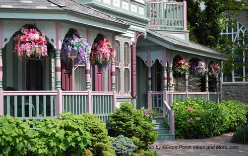 Victorian home has gorgeous front yard landscaping including beautiful hanging baskets