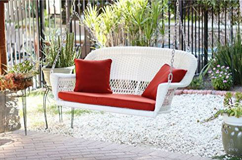 white jeco porch swing with bright red cushions and pillows