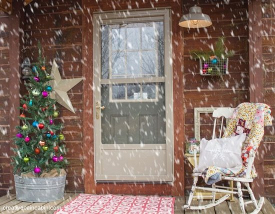 Christmas porch decorating - Creative Cain Cabin - small porch with Christmas tree and rocking chair
