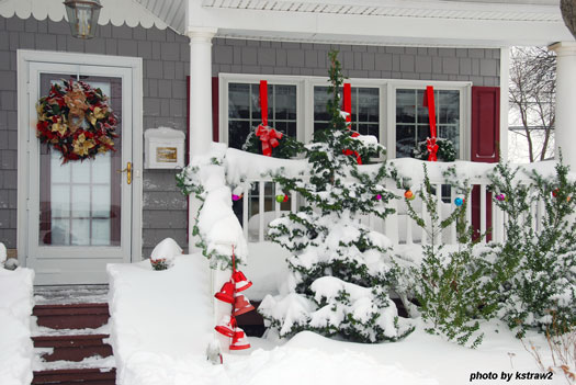 country farm house decorated with Christmas wreaths on windows