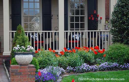 Colorfully landscaped front porch