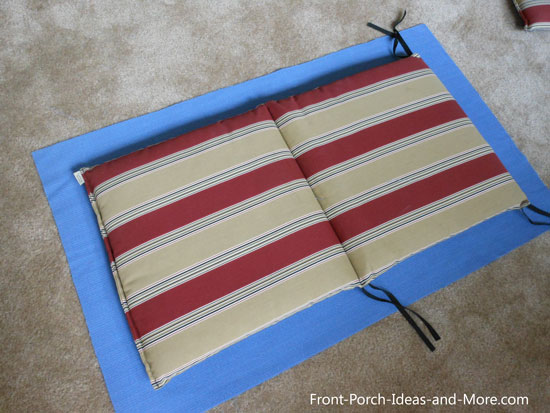 Lay cushion on fabric to ensure you have enough allowance all the way around.