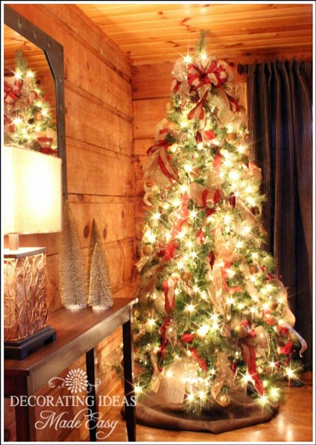 beautiful log home decorated for Christmas