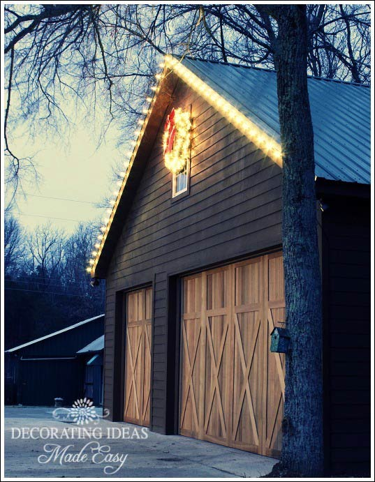 log cabin garage decorated for Christmas