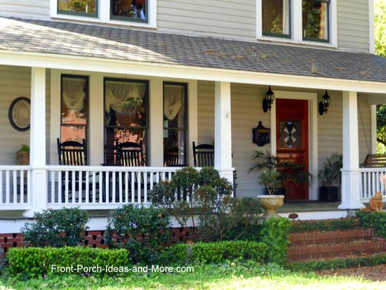 gray country style porch with rockers and porch swing
