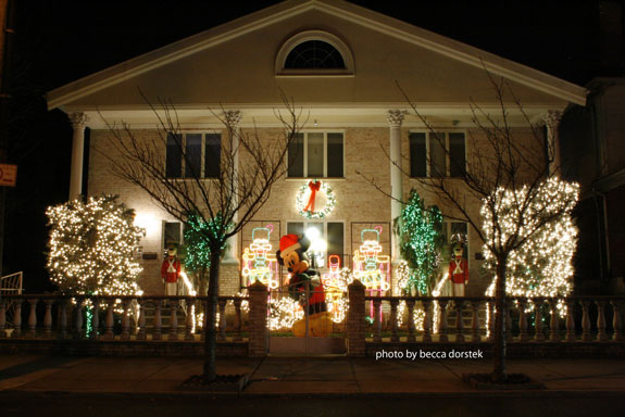 front of house lit with christmas lights and decorations