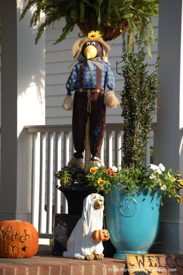 fun magpie on front porch for halloween